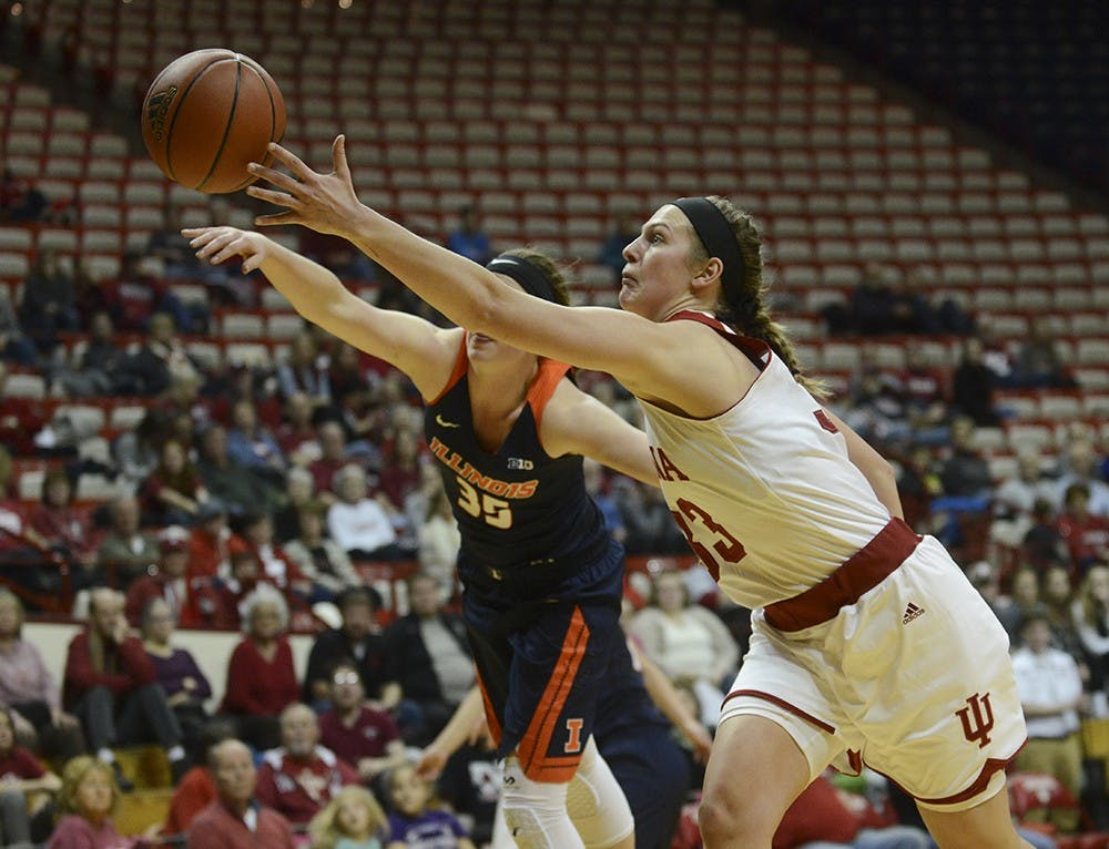 Sophomore foward Amanda Cahill goes after the loose the ball during the game against Illinois on Wednesday at Assembly Hall.