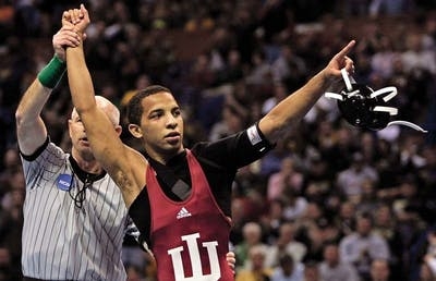 Indiana's Angel Escobedo celebrates his victory over Minnesota's Jayson Ness in a 125 pound championship match at the NCAA wrestling national championships Saturday, March 22, 2008 in St. Louis.(AP Photo/Tom Gannam)