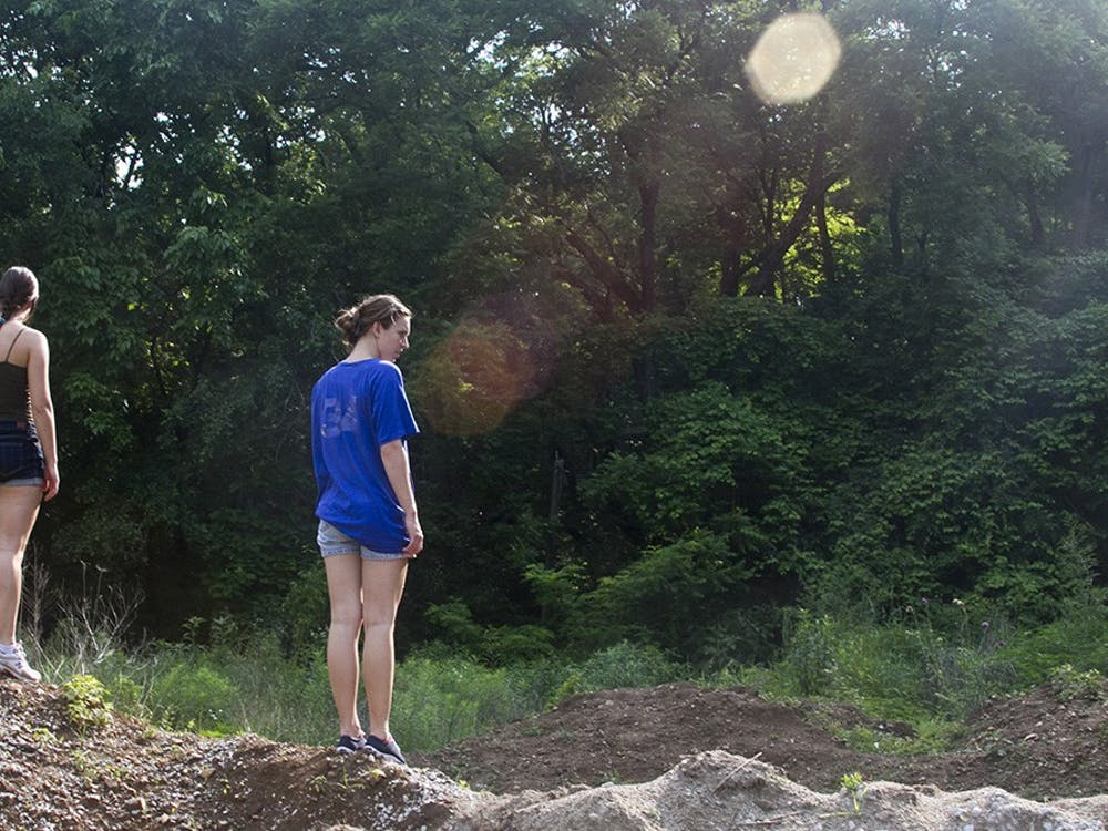 Marli Haddan and Hana Cleveland stand on piles of dirt, looking for clues on June 11, 2011 at Cascade park on the search for Lauren Spierer.