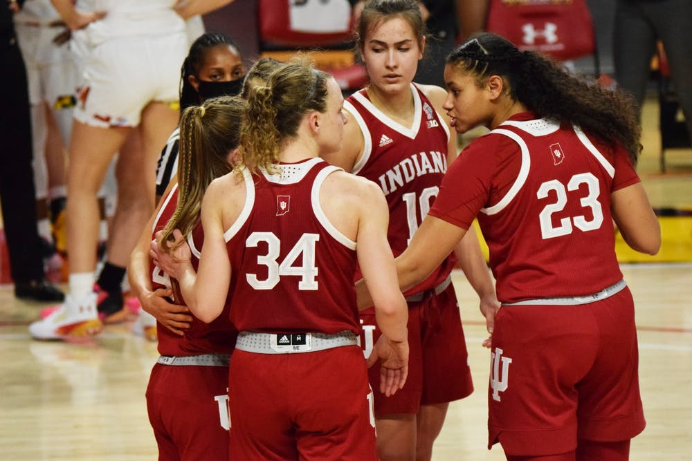 <p>Junior guard Grace Berger and freshman forward Kiandra Browne lead a team huddle Jan. 4 at Xfinity Center in College Park, Maryland. IU lost 80-84 in a narrow game against Maryland. </p>