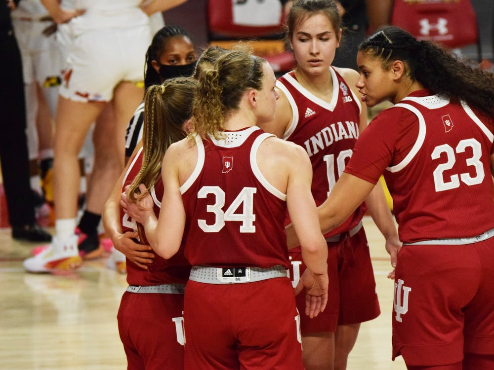 Junior guard Grace Berger and freshman forward Kiandra Browne lead a team huddle Jan. 4 at Xfinity Center in College Park, Maryland. IU lost 80-84 in a narrow game against Maryland.