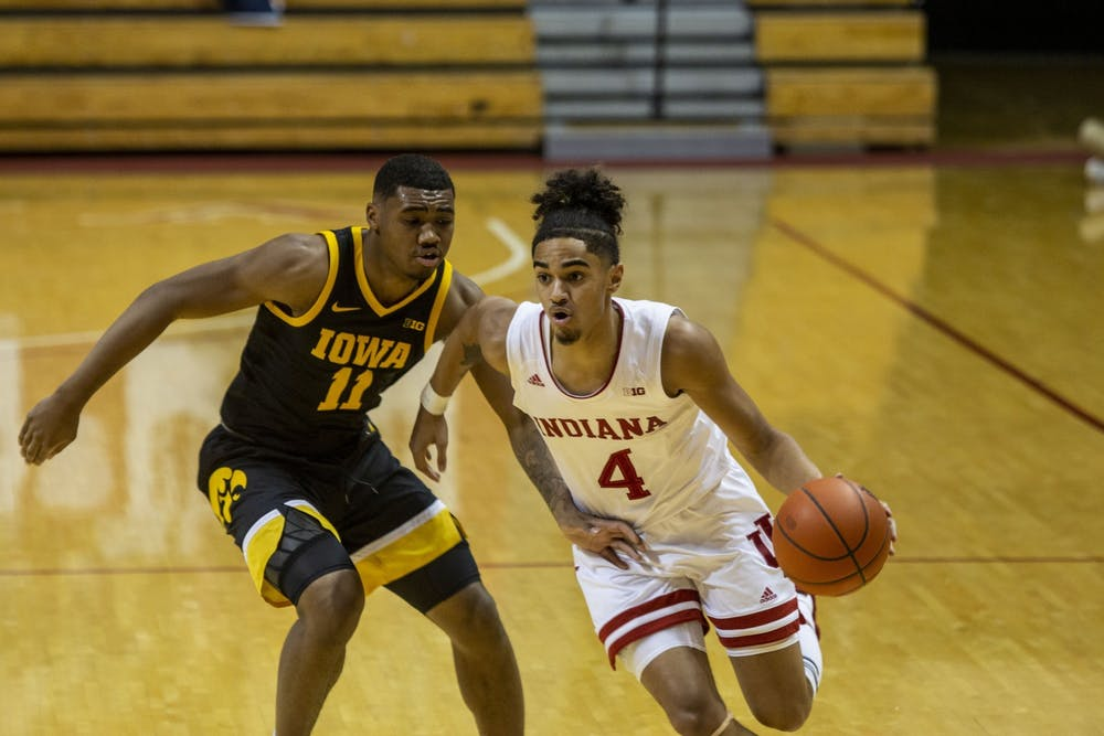 <p>Freshman guard Khristian Lander dribbles the ball up the court on Feb. 7 at Simon Skjodt Assembly Hall. Lander announced Monday that he will withdraw from the transfer portal to remain at IU.</p>