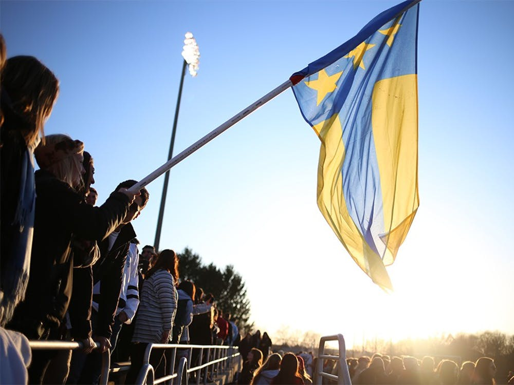 Fans hold the Alpha Tau Omega flag in the stands of Bill Armstrong Stadium during Little 500 Qualifications on March 28, 2015. . ATO will not compete in the 2016 Little 500 due to the fraternity having their charter revoked last semester.