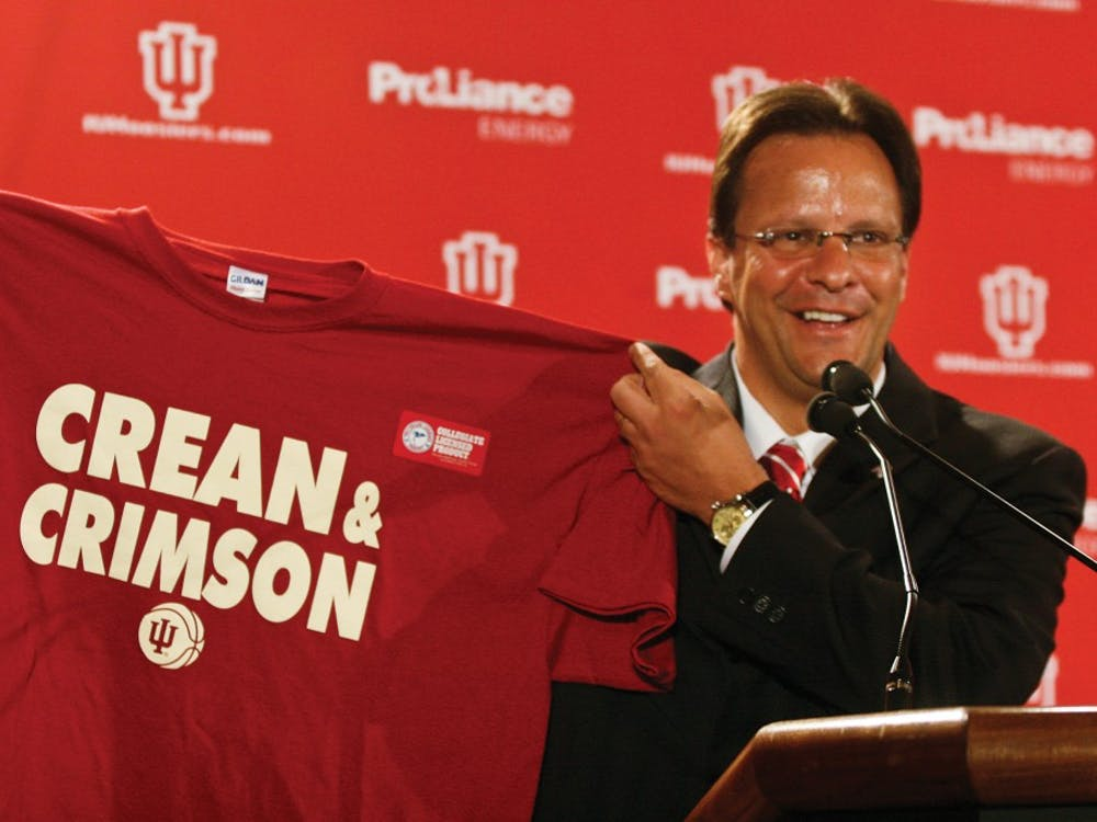 """Jacob Kriese •IDSNew IU head coach Tom Crean holds a T-shirt that says """"Crean & Crimson"""" during a press conference Wednesday afternoon in the Hoosier Room. Crean was hired Wednesday after a two week search."""