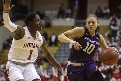 Sophomore guard Bendu Yeaney guards Northwestern sophomore guard Lindsey Pulliam on a drive to the basket in the first half of the women's basketball game Jan. 16 at Simon Skjodt Assembly Hall.