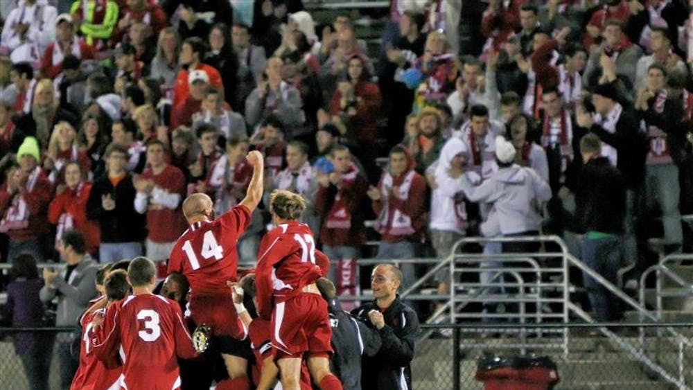 IU sophomore Neil Wilmarth salutes the crowd following his goal assist to Andy Adlard during the Hoosiers 3-1 win against No. 9 Notre Dame on Thursday night at Bill Armstrong Stadium.
