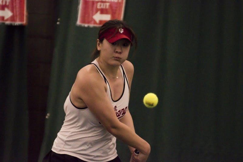 Senior Xiwei Cai lines up a backhand during her 6-2, 6-1 win over Miami University.