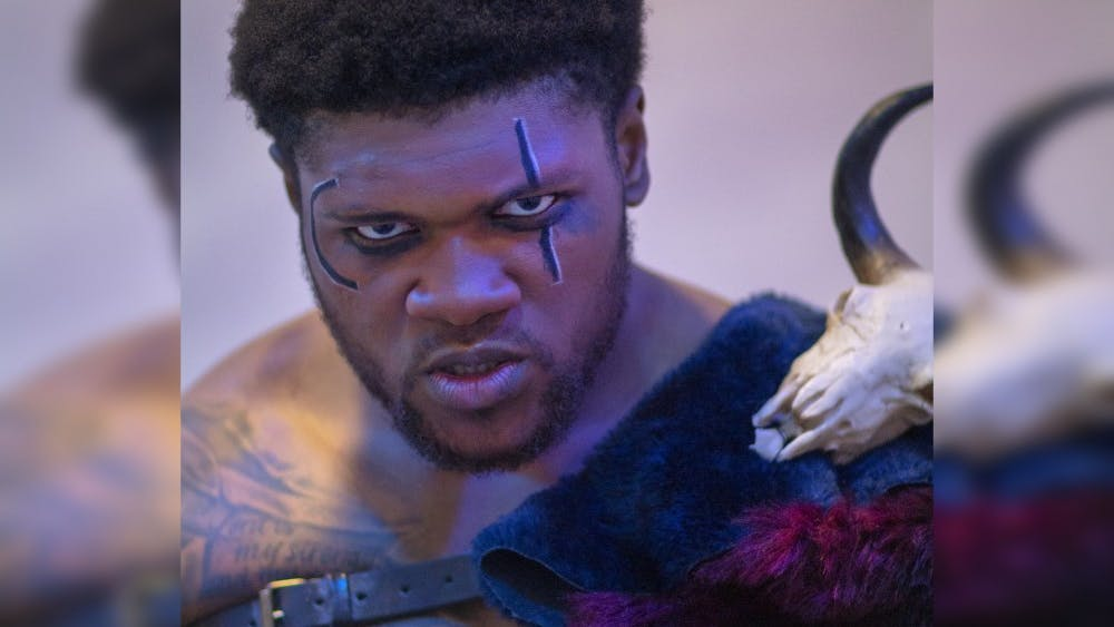 """Graduate student Kenneth Arnold portrays Aaron the Moor in IU Theatre's production of """"Titus Andronicus."""" Arnold played football for IU his entire undergraduate career and began acting in 2016."""