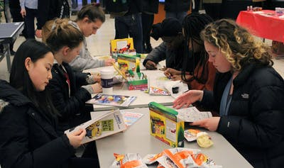 Students color in coloring books in the Herman B Wells Library. The IDS talked to students about how they reduce their finals week stress.
