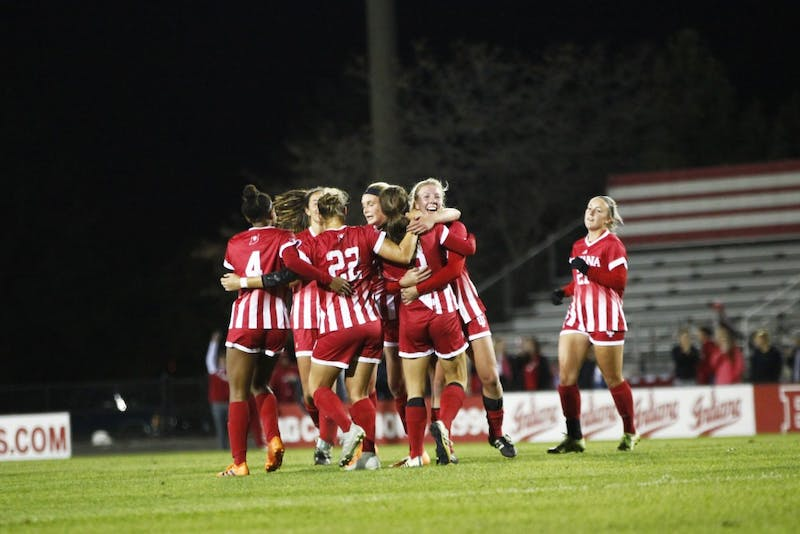 IU huddles together after scoring its only goal of the game Oct. 18 at Bill Armstrong Stadium. IU lost its last home game to Penn State, 1-4.