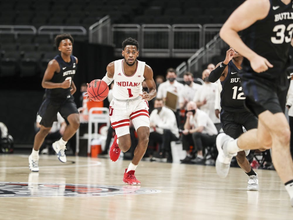 Senior guard Aljami Durham dribbles up the court Dec. 19 at Bankers Life Fieldhouse in Indianapolis. IU defeated Butler University 68-60 in the Crossroads Classic.