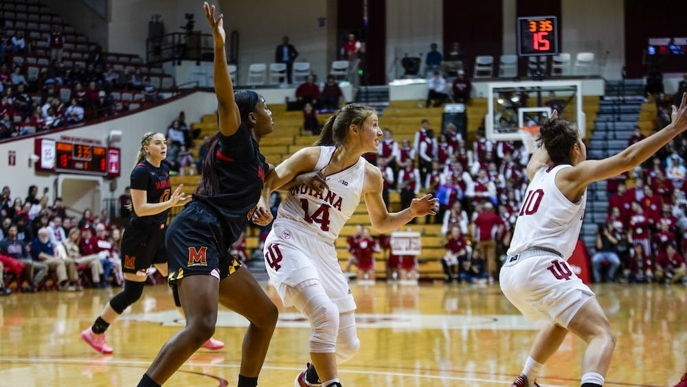 Redshirt junior Ali Patberg fights to defend senior Kaila Charles on Feb. 6 in Simon Skjodt Assembly Hall. The Hoosiers will play Illinois on Thursday.Correction: A previous version of this caption misspelled Ali Patberg's name. The IDS regrets this error.