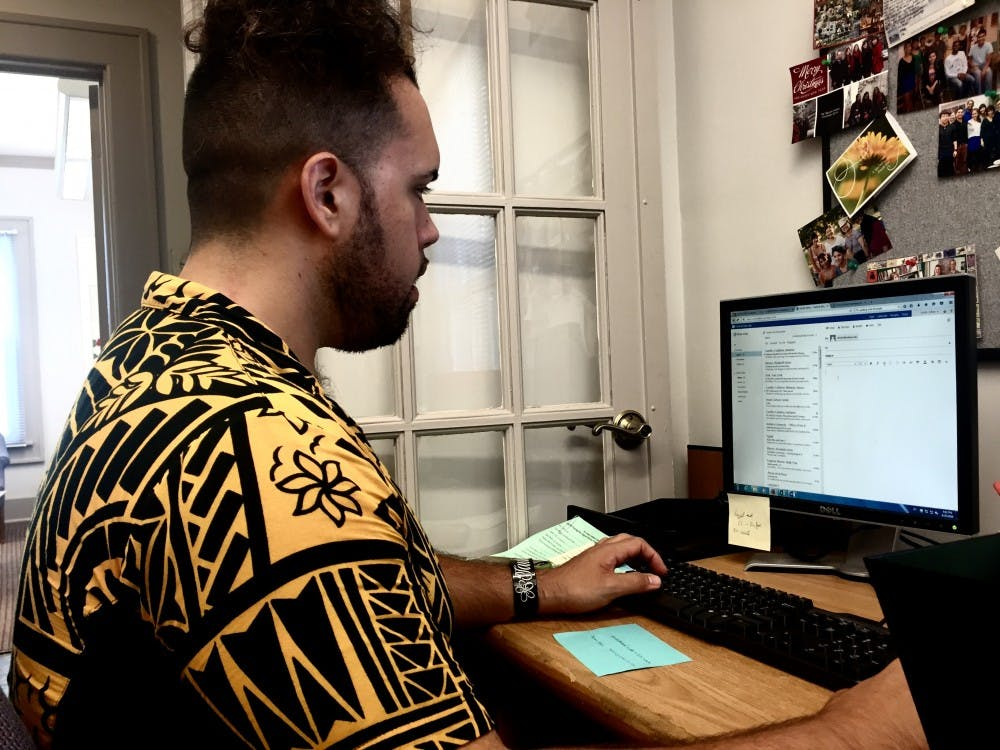 Dillon Tautunu-Smith, an Asian Culture Center member, creates the schedules Thursday, for the new tutors in the center's office. These volunteers help tutor students who need assistance with speaking English, dealing with cultural differences with others, and assisting anyone who needs guidance.