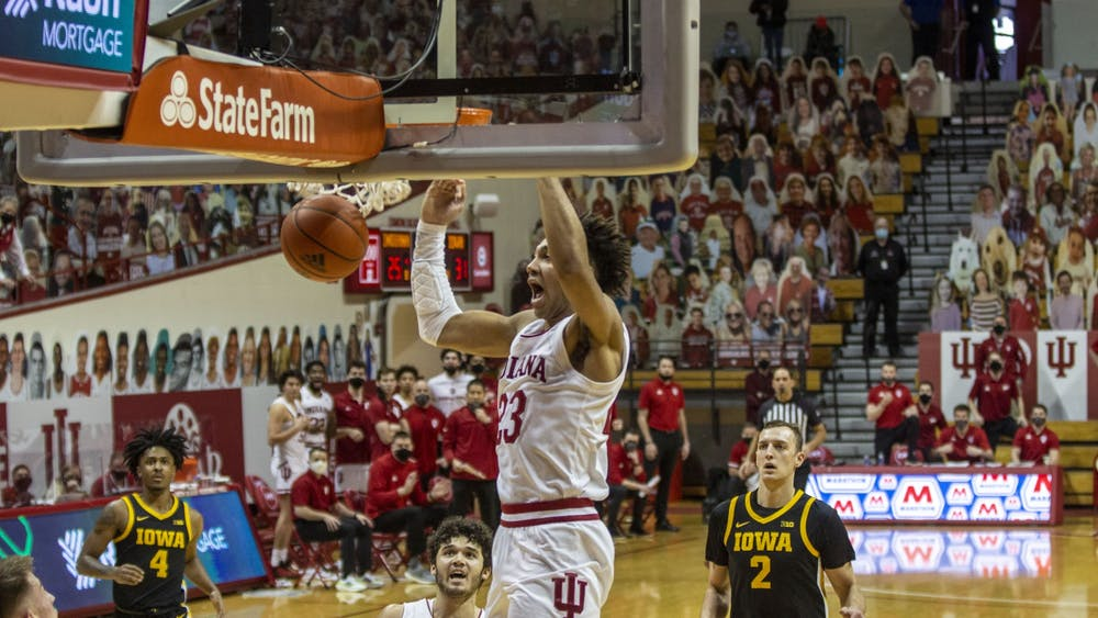 Sophomore forward Trayce Jackson-Davis dunks the basketball after a fastbreak late in the first half Sunday at Simon Skjodt Assembly Hall. IU led No. 8 Iowa 33-31 at halftime Sunday.