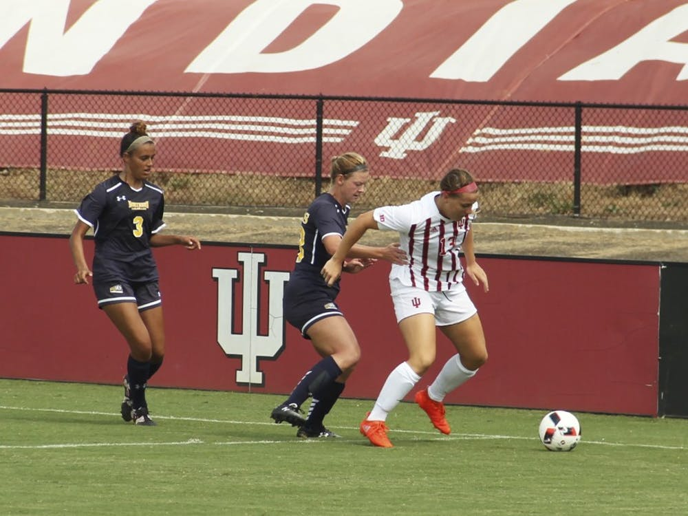 IU junior forward Maya Piper shields the ball from opposing players against Northern Colorado last season at Bill Armstrong Stadium. Piper and the Hoosiers began Big Ten play with a 1-1 record after weekend matches against Michigan State and Michigan.