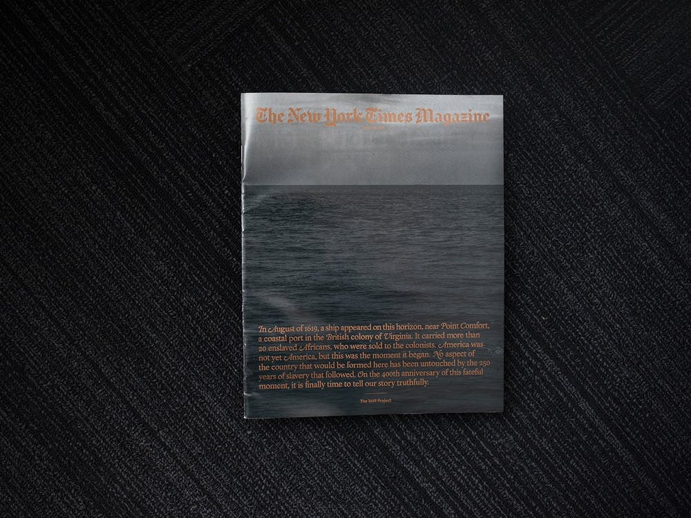 "A copy of the New York Times Magazine's ""The 1619 Project"" is photographed Aug. 19, 2019, in Chicago. President Donald Trump has pushed for the project, which aims to accurately portray the history of America and slavery, to be banned from schools."