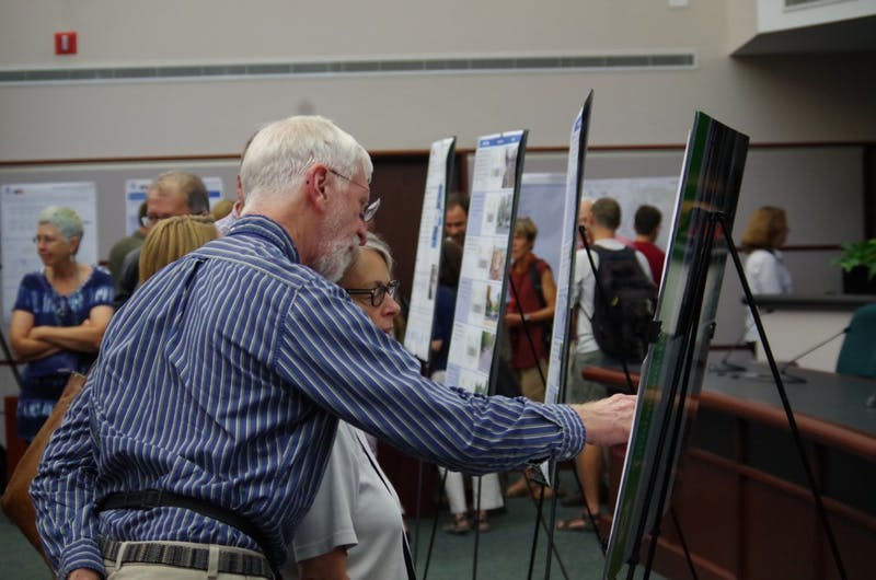 Bloomington residents review the draft of the city's new transportation plan that was presented for public comment Thursday night at City Hall.