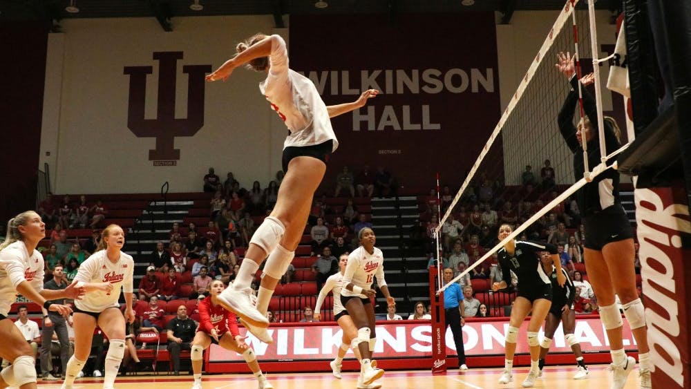 Sophomore Kari Zumach approaches for a hit Aug. 30 against Marshall University. The Hoosiers opened play at Wilkinson Hall with a pair of wins in the first day of the Indiana Invitational.