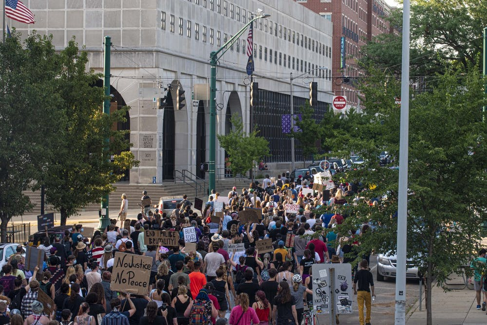 <p>Black Lives Matter protesters march July 7, 2020, on College Avenue. </p>