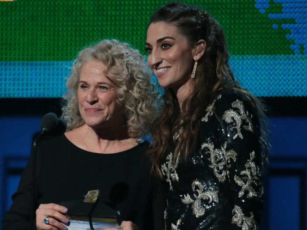 Carole King, left, and Sara Bareilles on stage to present Song of the Year Grammy at the 56th Annual Grammy Awards at Staples Center in Los Angeles on Sunday, Jan. 26, 2014. (Robert Gauthier/Los Angeles Times/MCT)