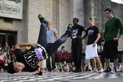 A member of the IU Break Dance Club performs during CultureFest outside the IU Auditorium.
