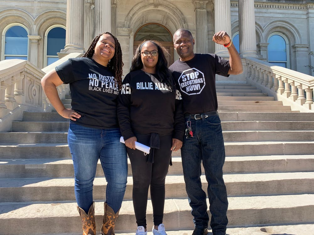 Wana Reed, Yvette Allen and Rodrick Reed pose Sept. 20 at the Vigo County Courthouse in Terre Haute, Indiana. All are family members of people on death row.
