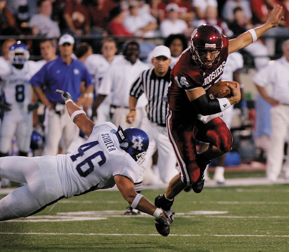 <p>Former IU quarterback Blake Powers leaps to avoid Kentucky&#x27;s Joe Schuler on Sept. 17, 2005, at Memorial Stadium. The Hoosiers defeated the Wildcats 38-14 in the last game of the series to date, which IU leads 18-17-1.</p>