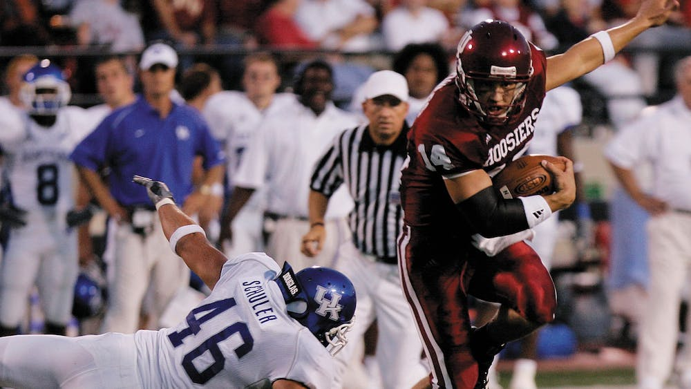 Former IU quarterback Blake Powers leaps to avoid Kentucky's Joe Schuler on Sept. 17, 2005, at Memorial Stadium. The Hoosiers defeated the Wildcats 38-14 in the last game of the series to date, which IU leads 18-17-1.