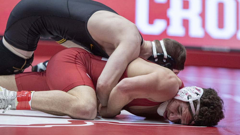 IU redshirt junior Liam Cronin wrestles Iowa junior Spencer Lee Jan. 10 in Wilkinson Hall. IU lost against Rutgers Jan. 24 7-29.