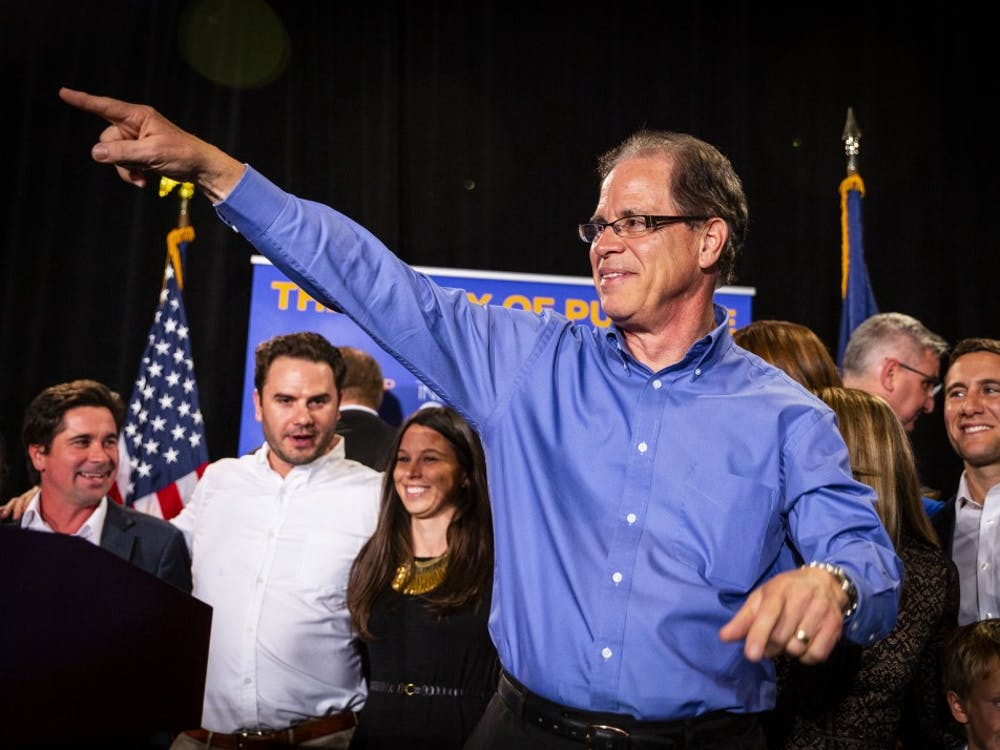 Sen. Mike Braun, R-Indiana, points to the crowd after winning the senate race Nov. 6 in the JW Marriott in Indianapolis.