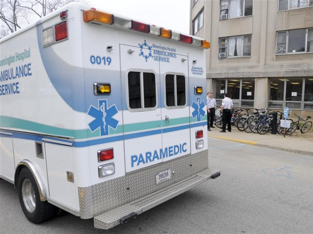 An ambulance and Bloomington Hospital paramedics wait outside Gucker Tower of Briscoe Quad after a reported death in a dorm room Tuesday at about 3:20 p.m. IU Police Department Chief of Police Keith Cash confirmed the death and said it was an apparent suicide.
