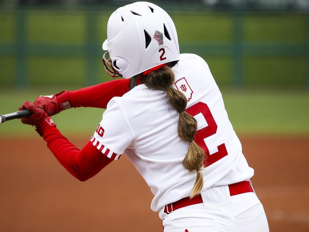 Freshman pitcher Macy Montgomery swings the bat March 28 at Andy Mohr Field. The Hoosiers won 7-5 Sunday against the Purdue Boilermakers.