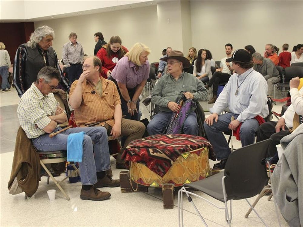 Native American drummers performed at FNECC's health dance Saturday while others danced while wearing traditional garb.