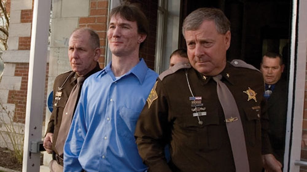 Police escort John Myers on Oct. 30, 2006, after a jury found him guilty of the 2000 murder of IU sophomore Jill Behrman at the Morgan County Courthouse. Myers will remain in jail and serve the remainder of his 65-year sentence after a court filing  which called for Myers' release was reversed Tuesday.
