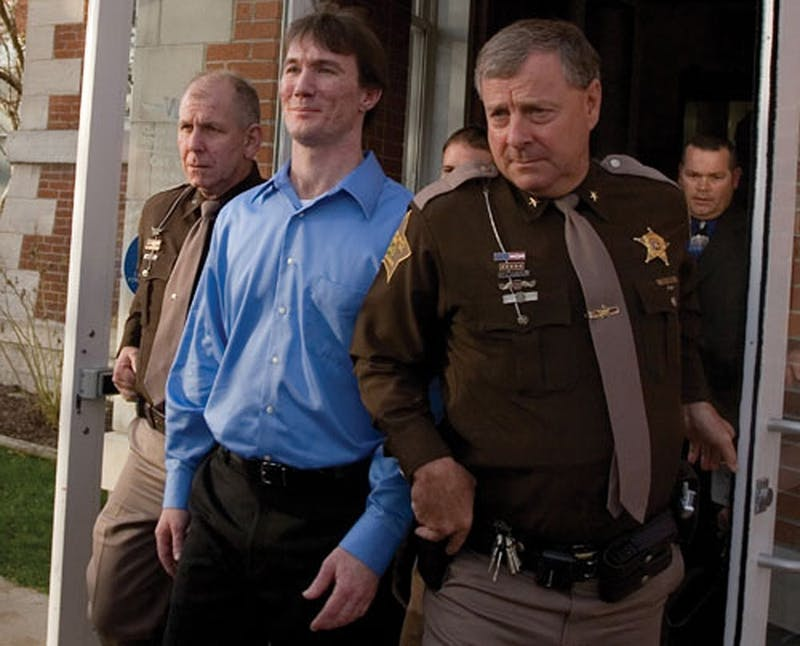 Police escort John Myers on Oct. 30, 2006, after a jury found him guilty of the 2000 murder of IU sophomore Jill Behrman at the Morgan County Courthouse. Myers is immunocompromised and was set to be released until the Seventh Circuit Court of Appeals makes a decision on the validity of his 2006 trial, but the Indiana attorney general's office filed an emergency motion to stop the order.