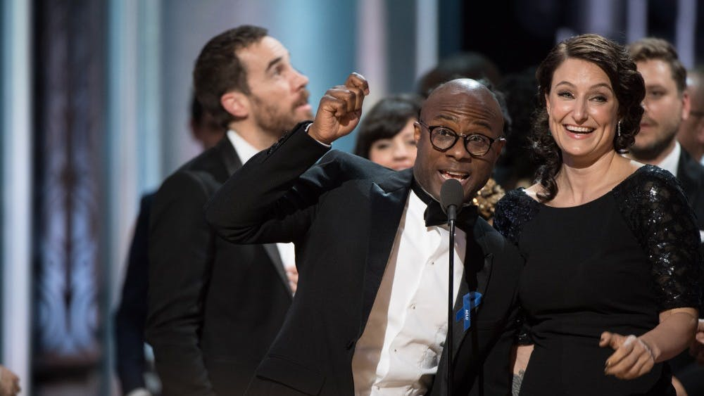 """Barry Jenkins, writer and director of """"Moonlight,"""" and producer Adele Romanski accept the Oscar for best picture during 2017 the Academy Awards. """"La La Land"""" was first read as the winner, but the actual winner was """"Moonlight."""""""