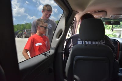 A Teen Academy participant conducts a mock traffic stop on Bloomington Police Department Officer Christopher Brummett. This year's Teen Academy will take place July 15-19.
