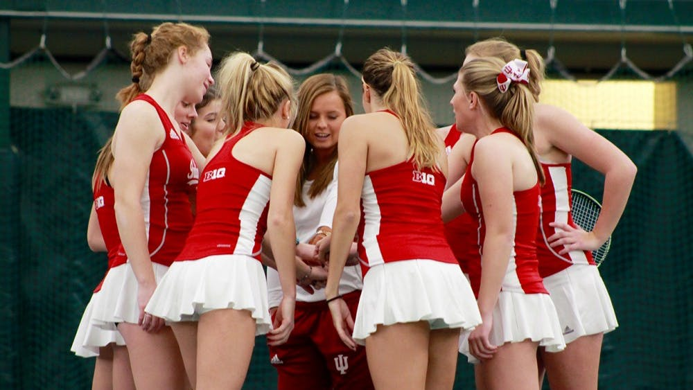 IU women's tennis huddles before a Saturday morning match against Notre Dame in 2017.
