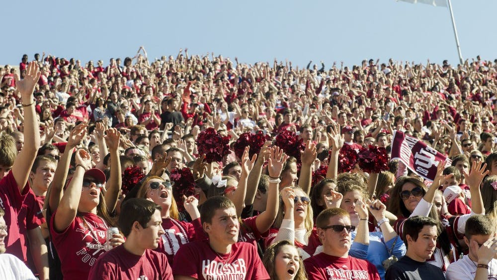Hoosier fans sing the IU Fight Song during IU's loss to Wisconsin on Saturday afternoon at Memorial Stadium.