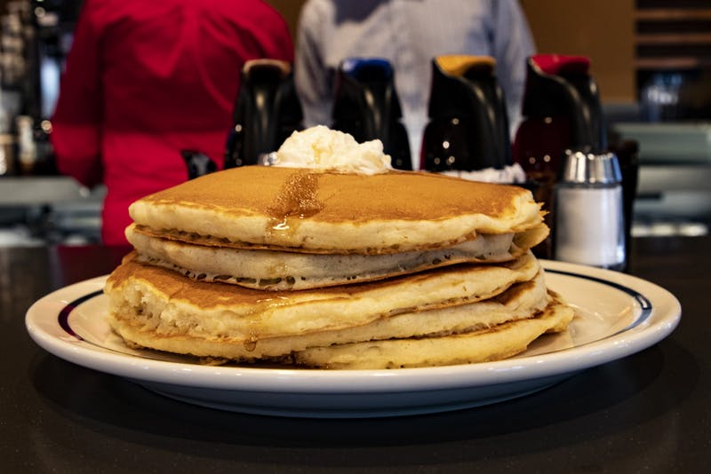 A plate of pancakes sits on a table Dec. 2 in IHOP. The food was served hot with butter on top.