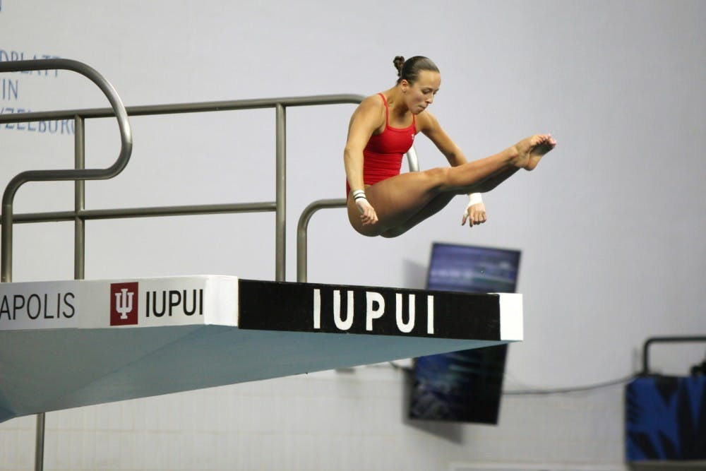 <p>Jessica Parratto warms up before the women&#x27;s synchronized 10-meter preliminaries at the 2016 U.S. Olympic Team Trials in Indianapolis. Parratto earned a silver medal in the 10-meter synchronized platform diving competition Tuesday.</p>