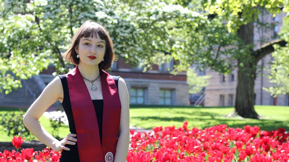 Rachel Cambron poses for a graduation photo on IU's campus.