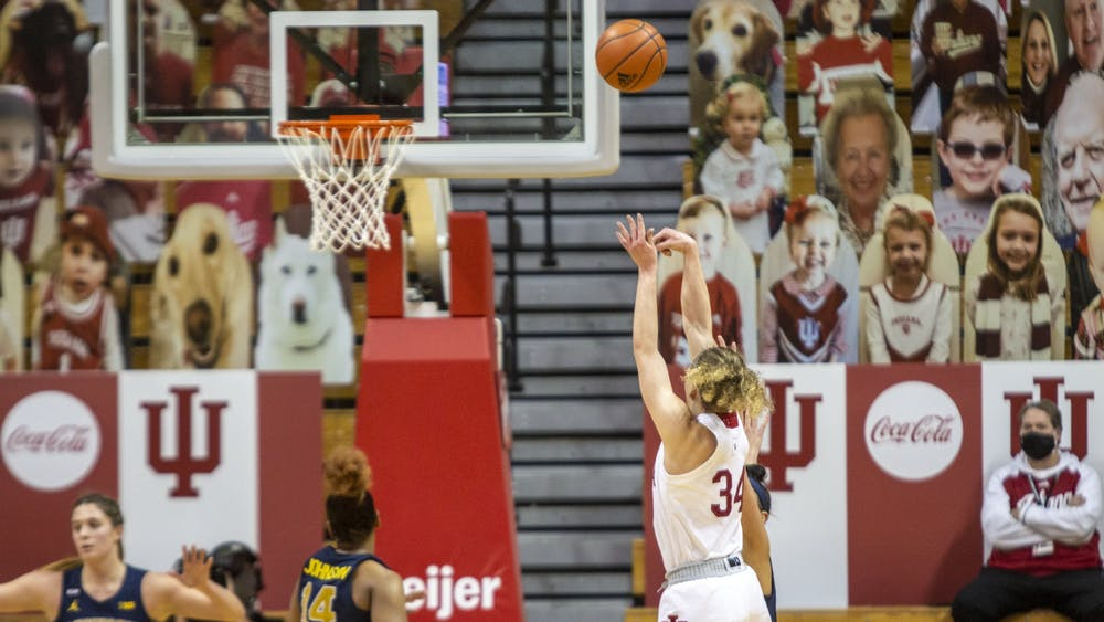 Junior guard Grace Berger attempts a shot Feb. 18 in Simon Skjodt Assembly Hall. IU beat Ohio State 87-75 Saturday.