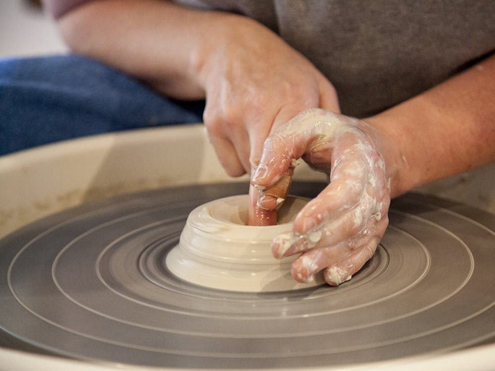 Rebecca Lowery is a Bloomington potter who works in a studio in her garage.  She threw clay on a wheel during a live demonstration at The Venue on Tuesday.