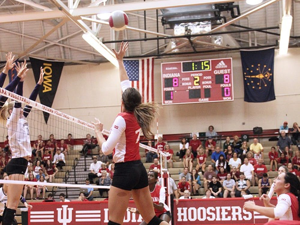 Senior outside hitter Jessica Leish spikes the ball against Northwestern at the University Gym on Sept. 21, 2016. Leish and the IU volleyball team will participate in the team's Cream and Crimson Day on Aug. 19 at the University Gym.