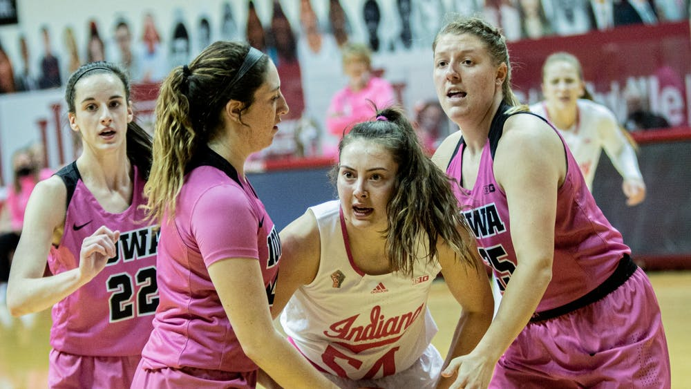 Sophomore forward Mackenzie Holmes reacts to a call against Iowa on Wednesday at Simon Skjodt Assembly Hall. The Hoosiers beat the Hawkeyes 89-80.
