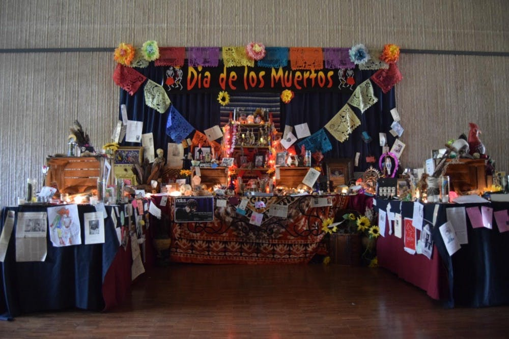 <p>A Day of the Dead alter in the Mathers Museum was created to honor those who have passed.</p>