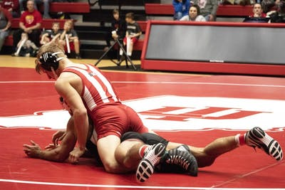 Freshman Kyle Luigs wrestles against Stanford University on Feb. 9 in Wilkinson Hall. IU won, 31-7.