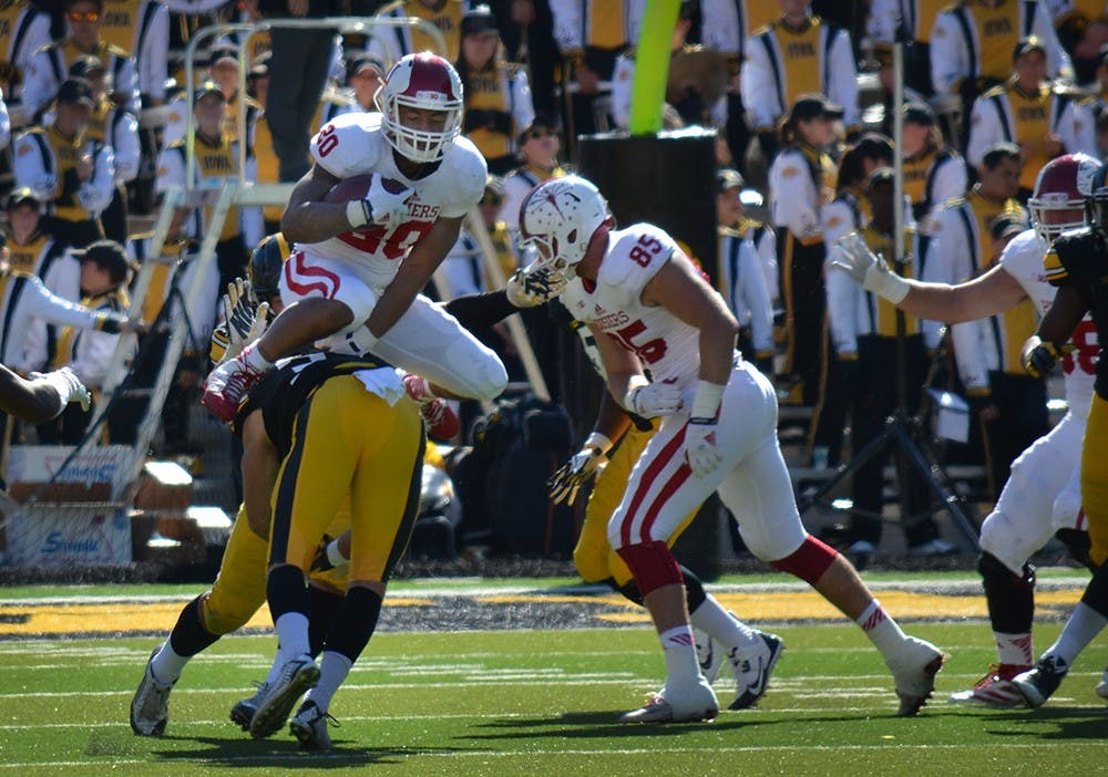 Senior running back D'Angelo Roberts jumps over a defender in IU's game against Iowa on Saturday at Kinnick Stadium in Iowa City, Iowa.
