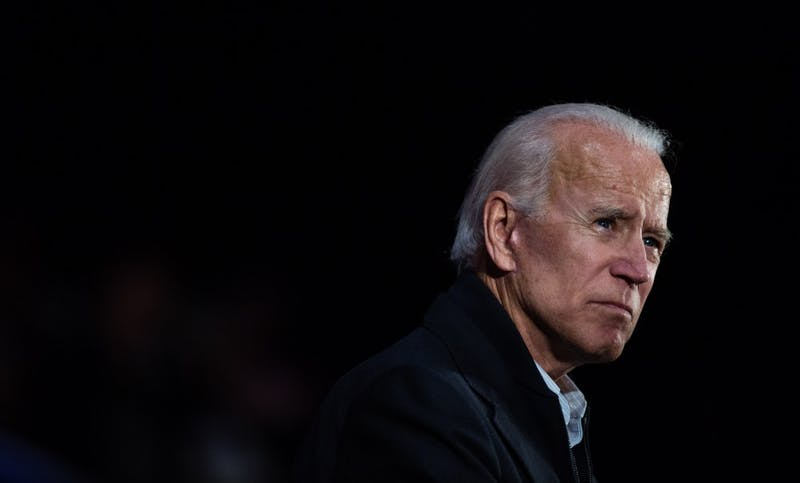 Former Vice President Joe Biden pauses while delivering a speech at a campaign rally for Sen. Joe Donnelly, (D-Indiana), on Friday, Oct. 12, at the Hammond Civic Center in Hammond, Indiana. Biden's speech touched on healthcare reform and early voting in the Indiana midterm elections.